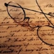 Caz's icon - a pair of glasses on old faded text